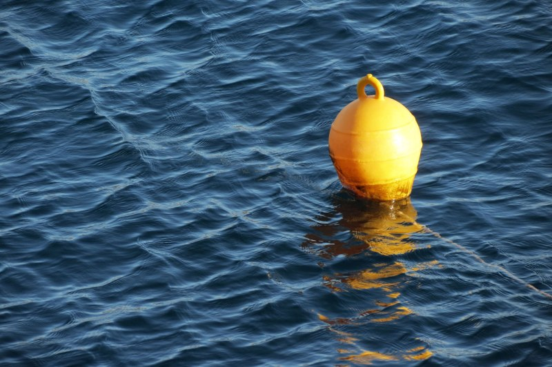 yellow buoy in blue sea